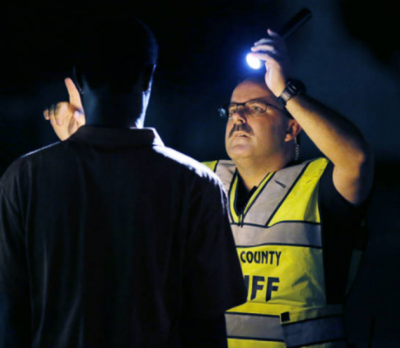 Police Officer Giving the DUI Eye Test